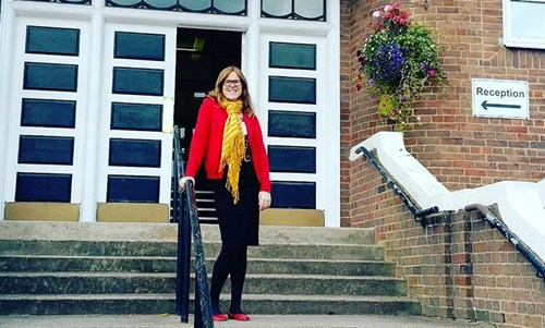 Megan Key standing outside her old school
